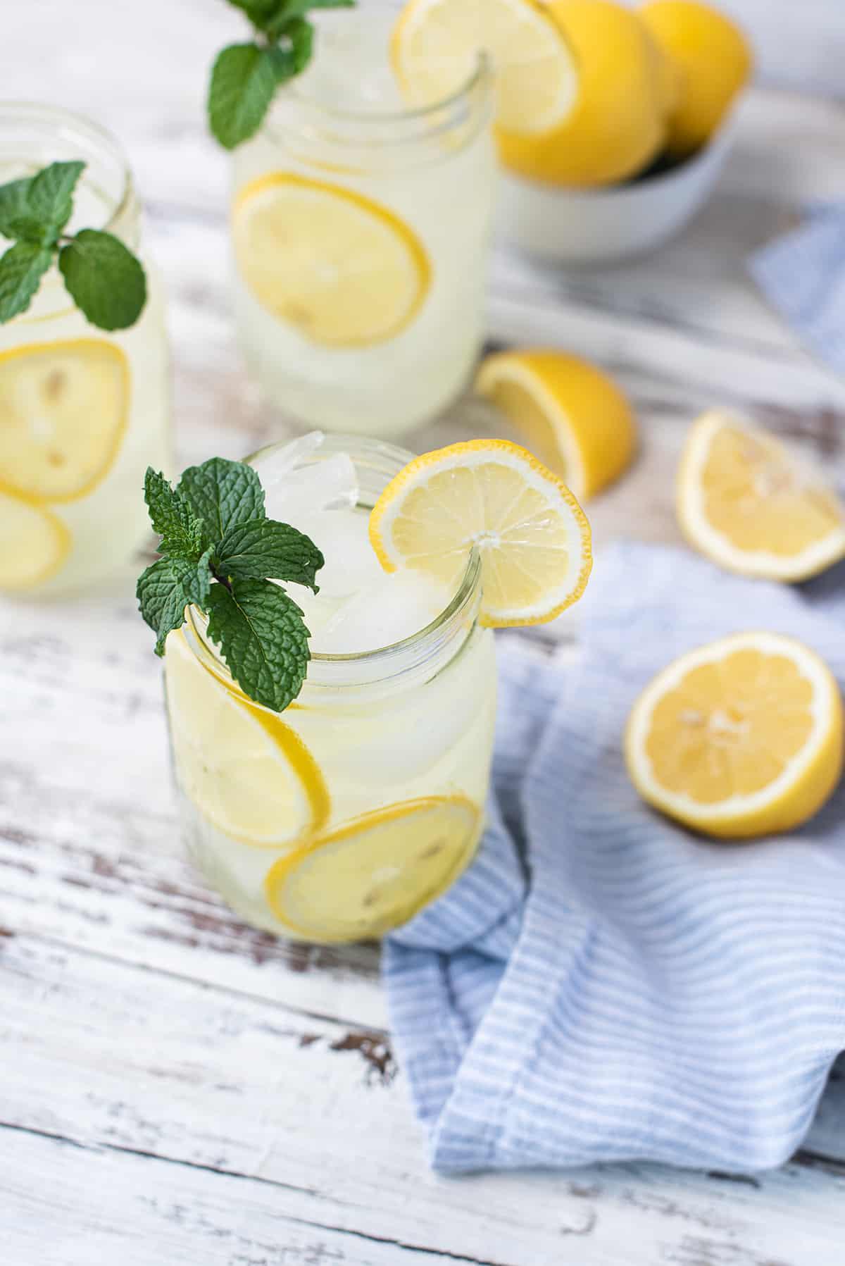 lemonade in mason jars with mint garnish & blue striped napkin
