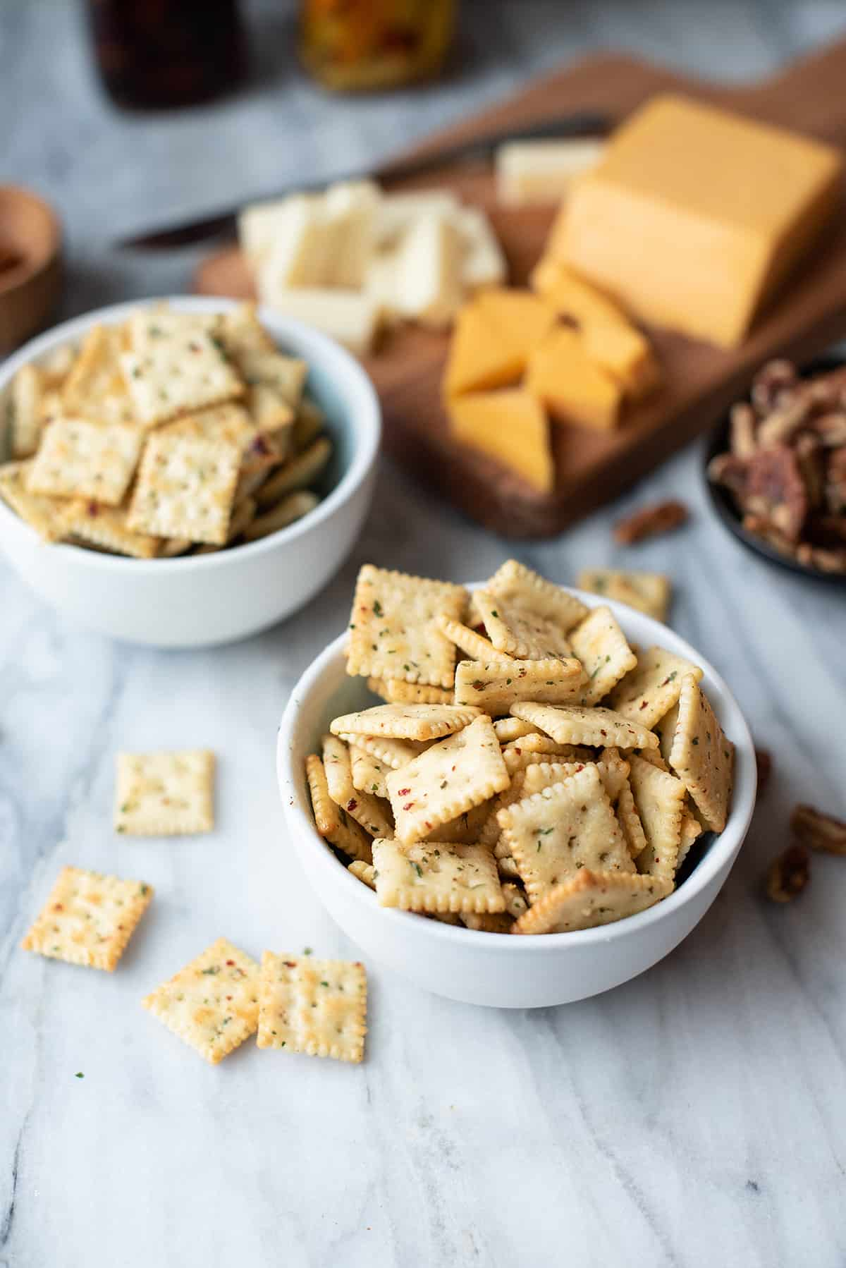 zesty cool ranch crackers (made with mini saltines) in bowl with cheese plate