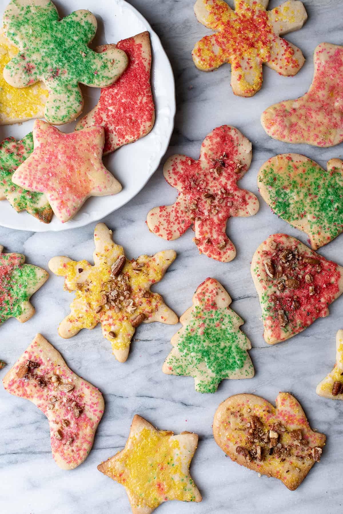 Christmas teekuchen cut-out cookies on white board