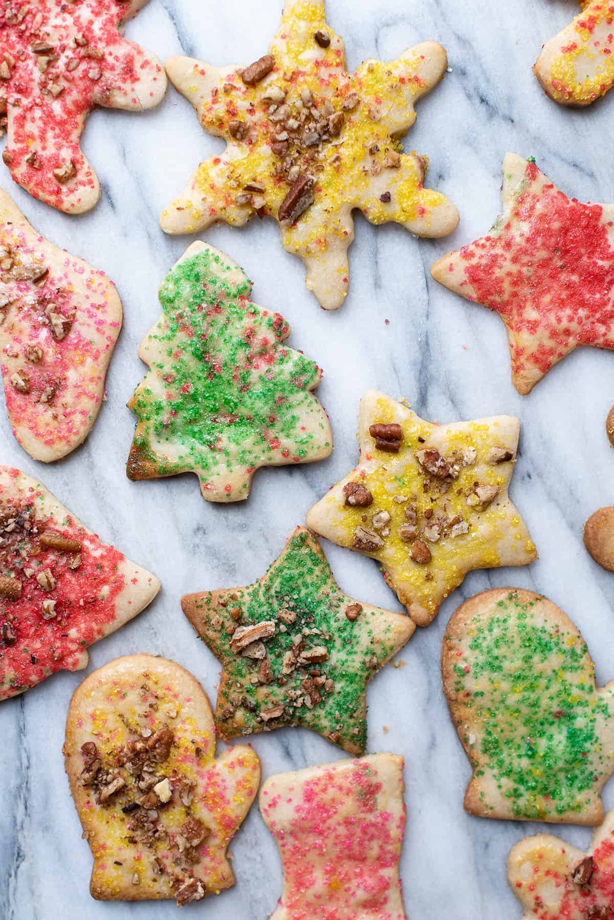 Christmas teekuchen cut-out cookies on marble table
