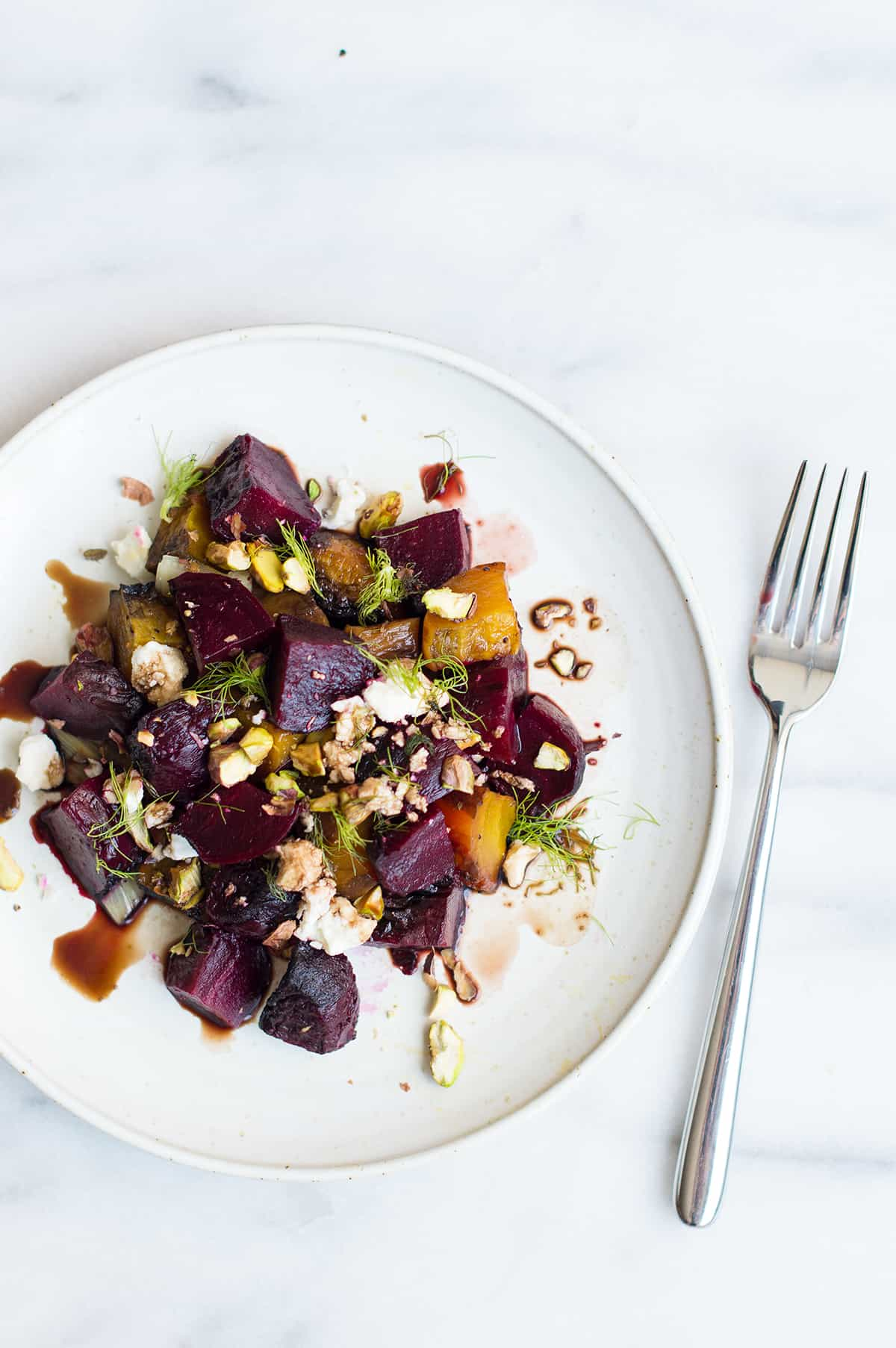 roasted fennel and beet salad on plate with fork