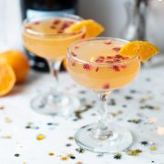 2 clementine champagne cocktails with confetti