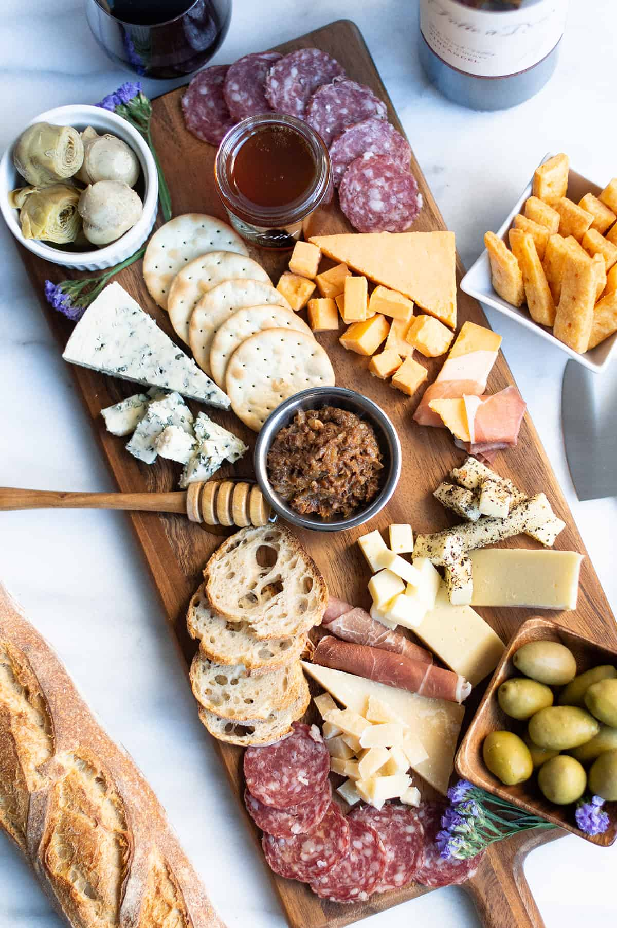 charcuterie board with savory three cheese crackers