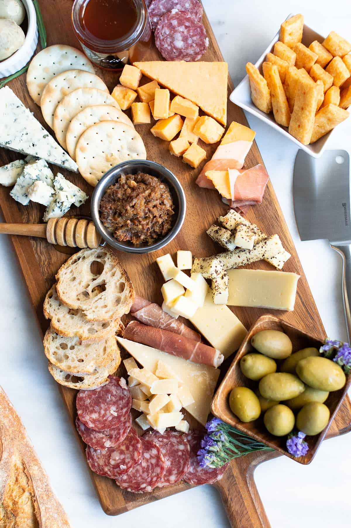 charcuterie board featuring savory three cheese crackers