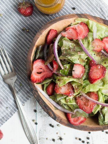 strawberry salad in bowl with fork