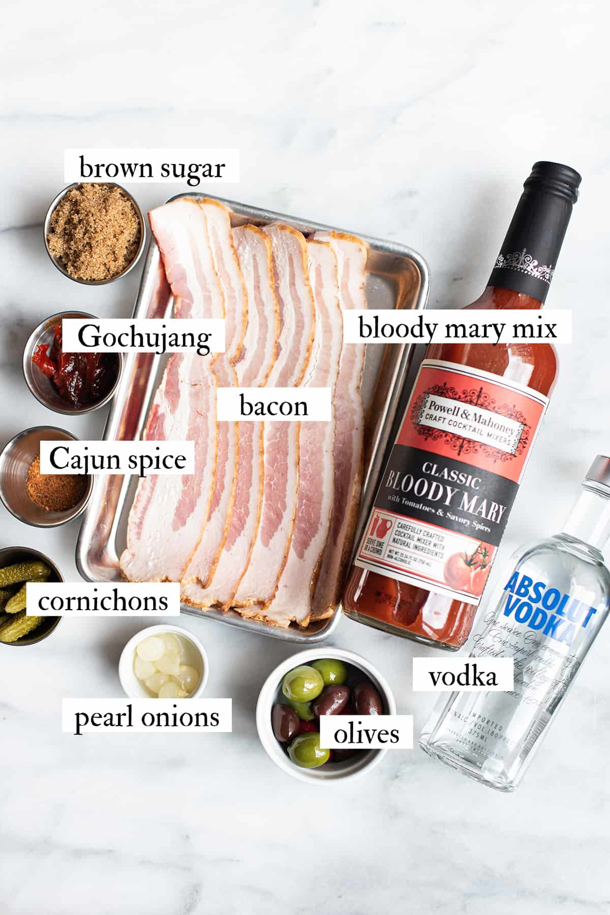 bacon Bloody Mary ingredients on marble surface