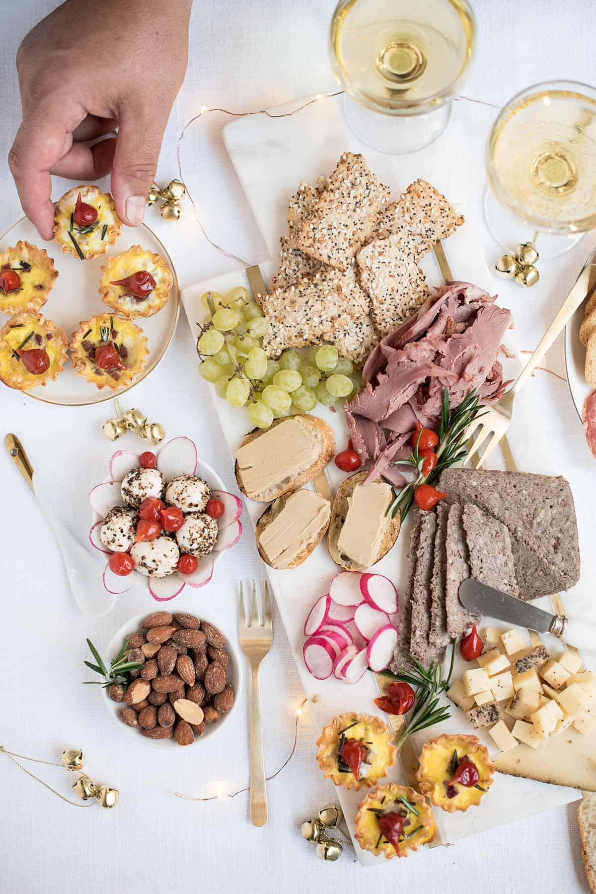 holiday champagne brunch charcuterie board with serving ware & crackers