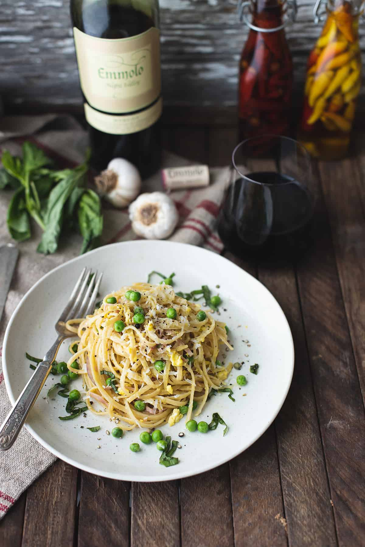 classic pasta carbonara on plate with fork