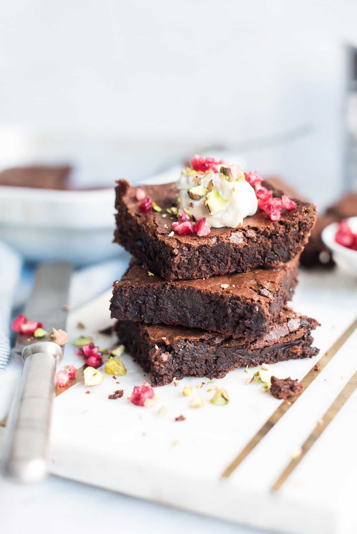 double chocolate olive oil brownie stack with whipped cream & pomegranate