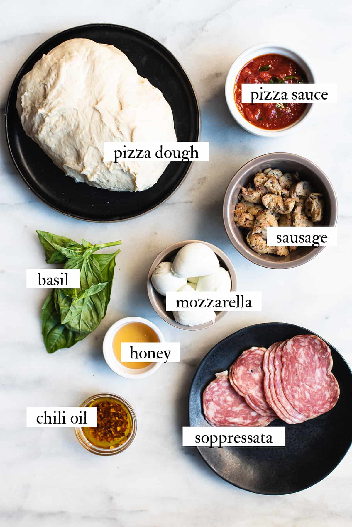 ingredients for bee sting pizza on marble surface