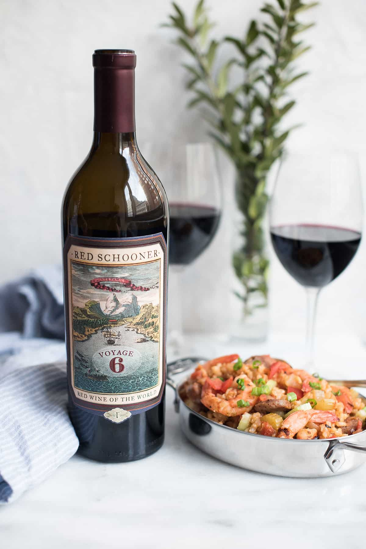 creole style shrimp jambalaya with red schooner wine bottle & glasses