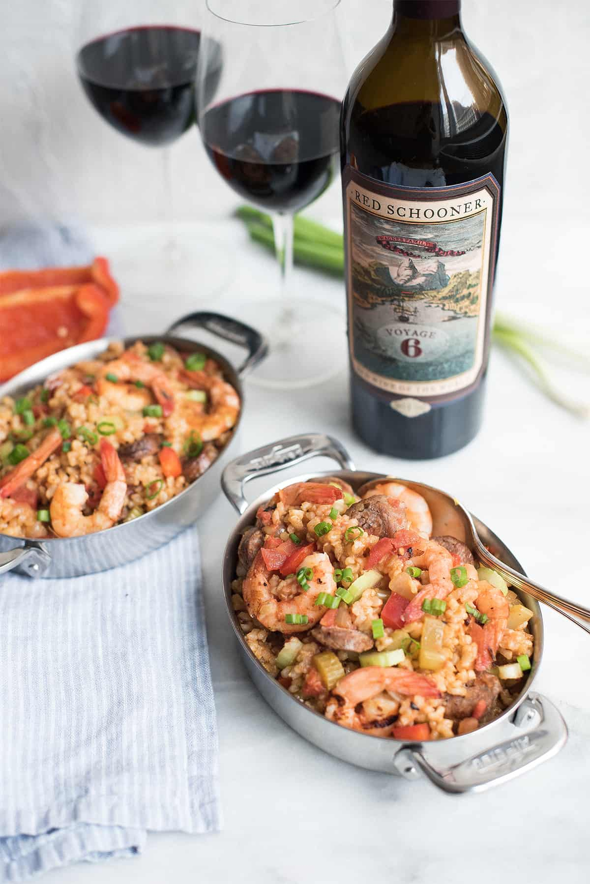serving pan of creole style shrimp jambalaya with red schooner wine