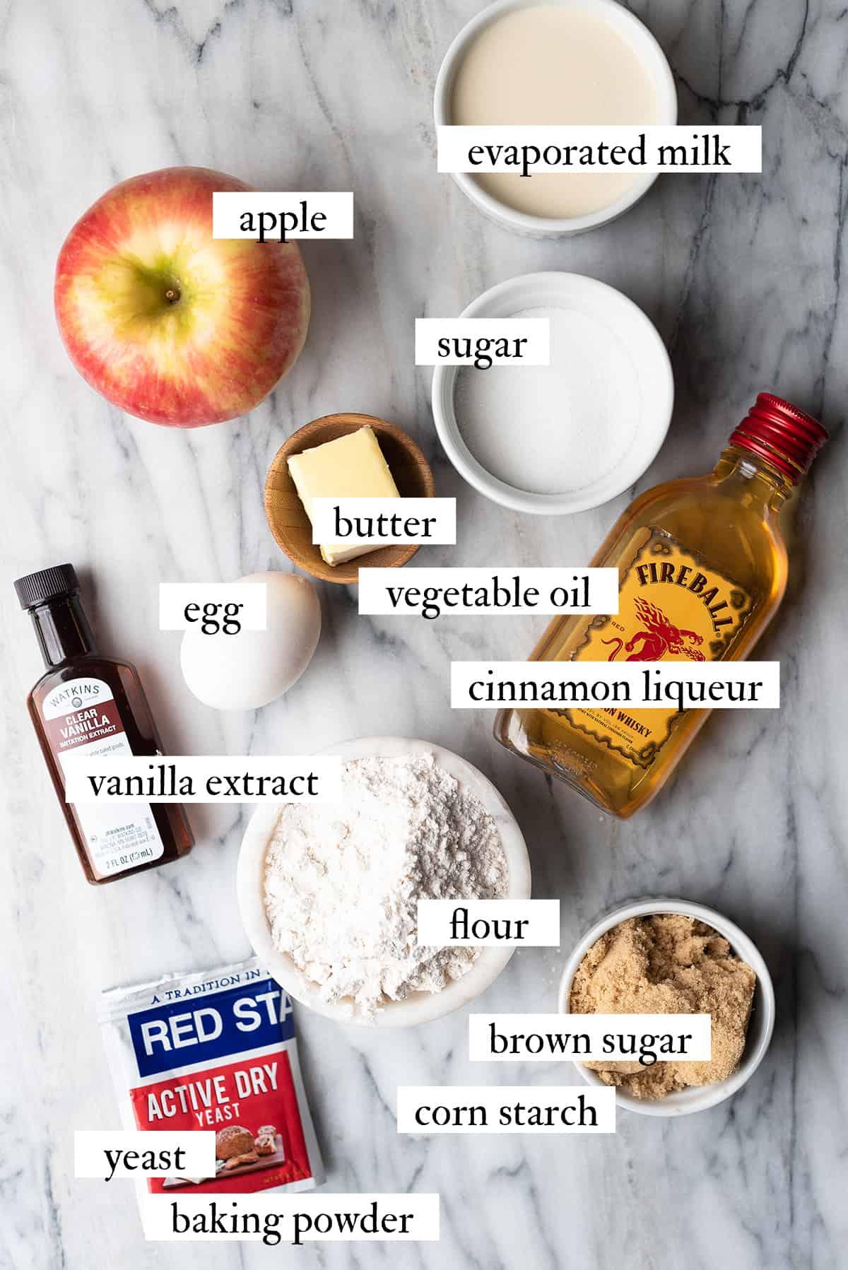 boozy apple beignet ingredients on marble surface