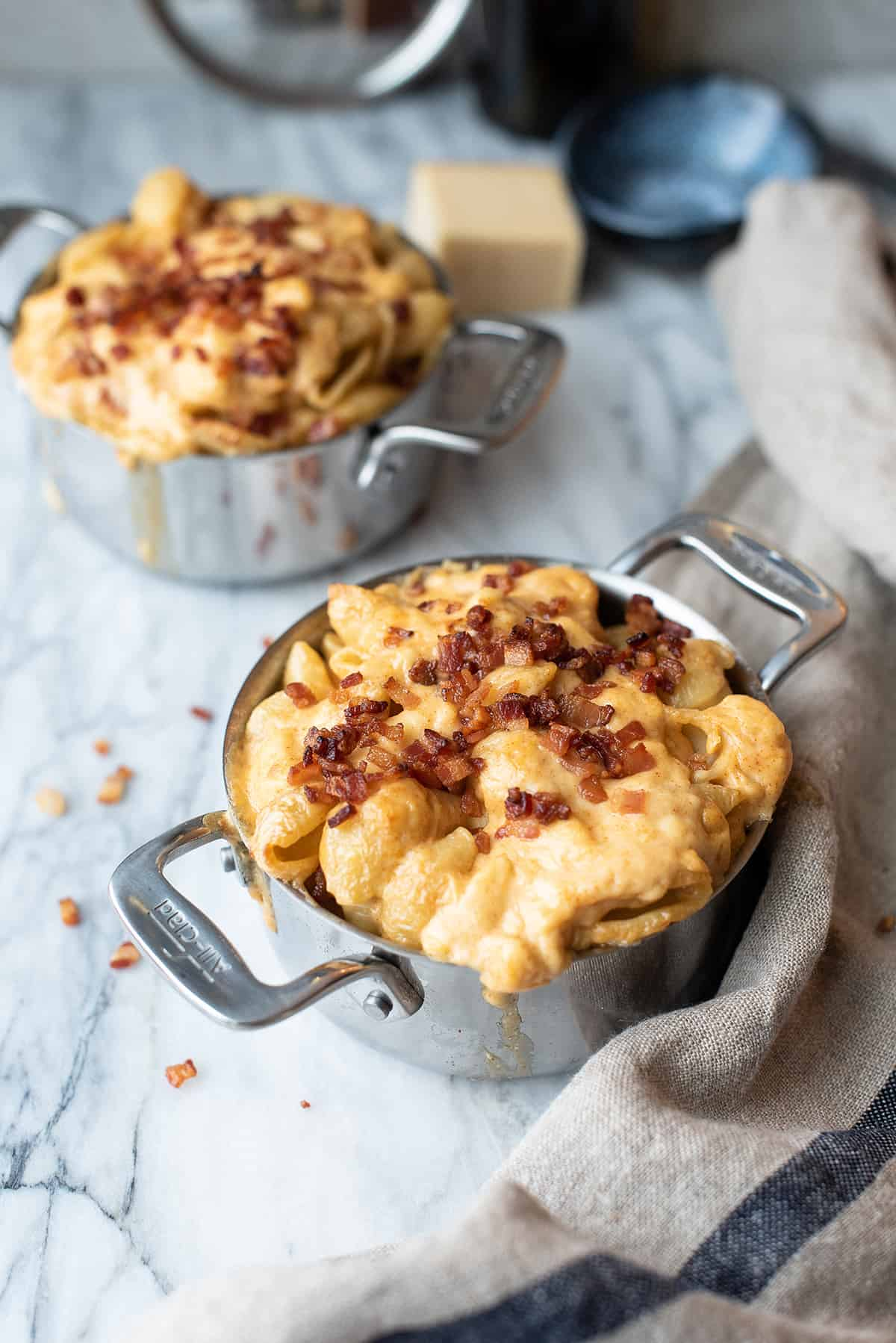 pan of smoked gouda mac & cheese with crumbled bacon on top
