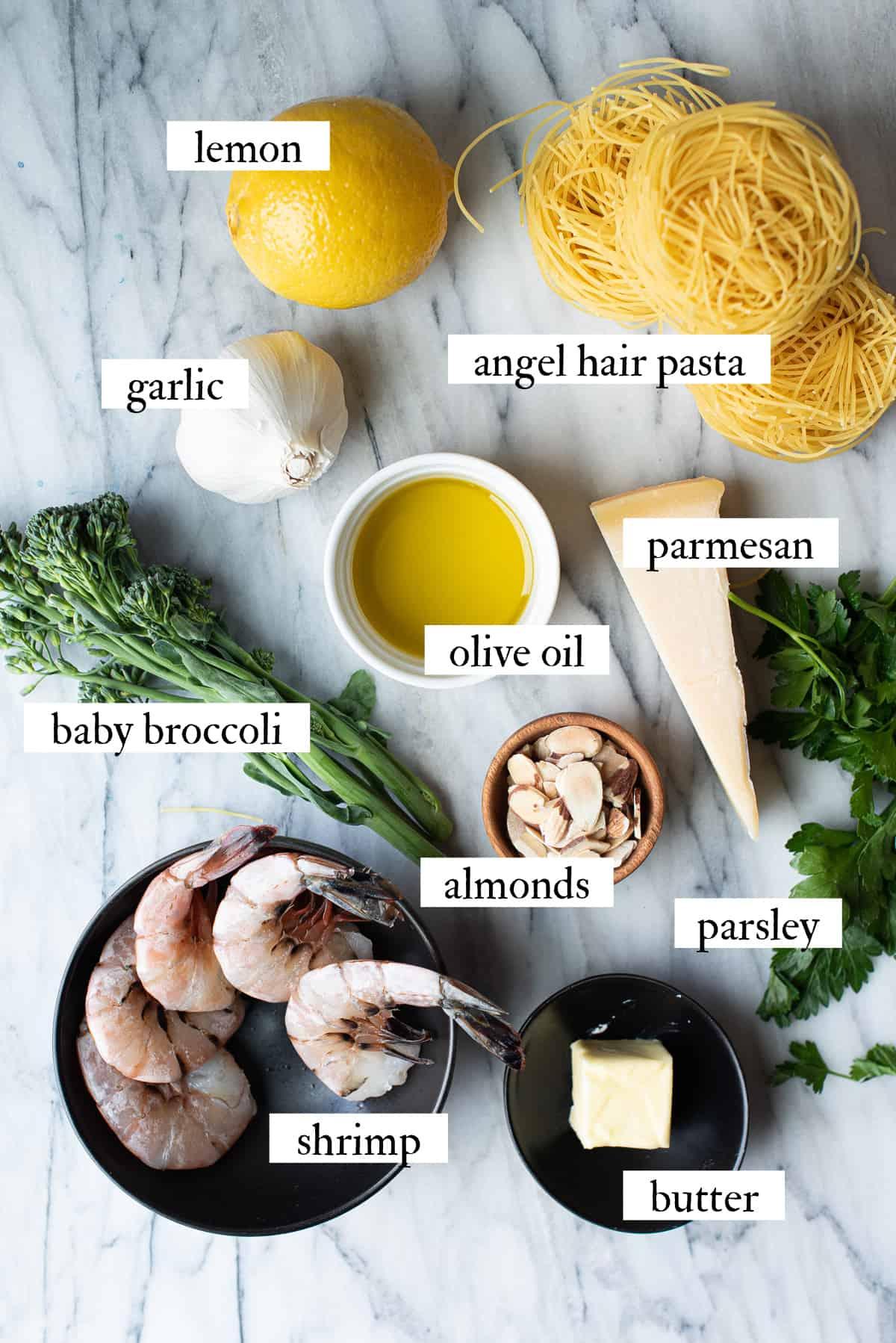 lemony shrimp pasta ingredients on marble surface