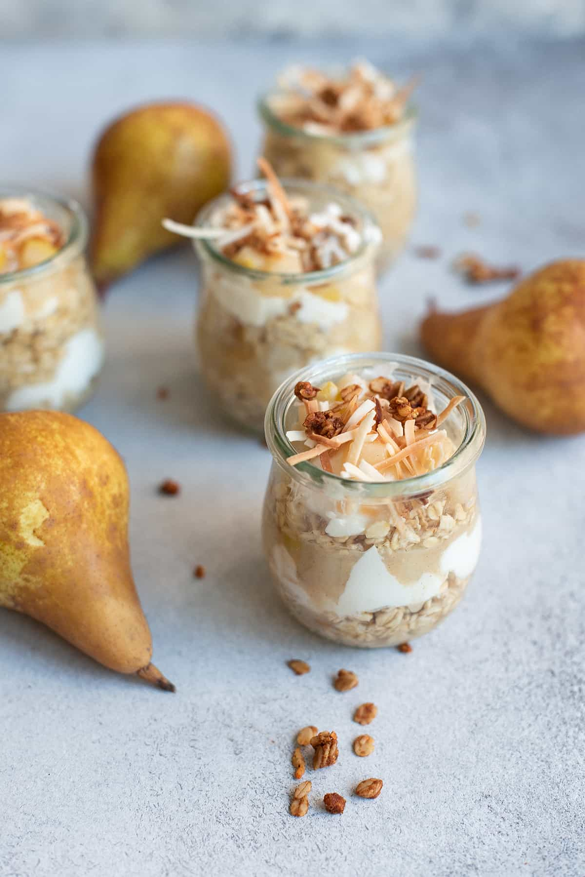 overnight oats pear parfaits in glass jars with pears