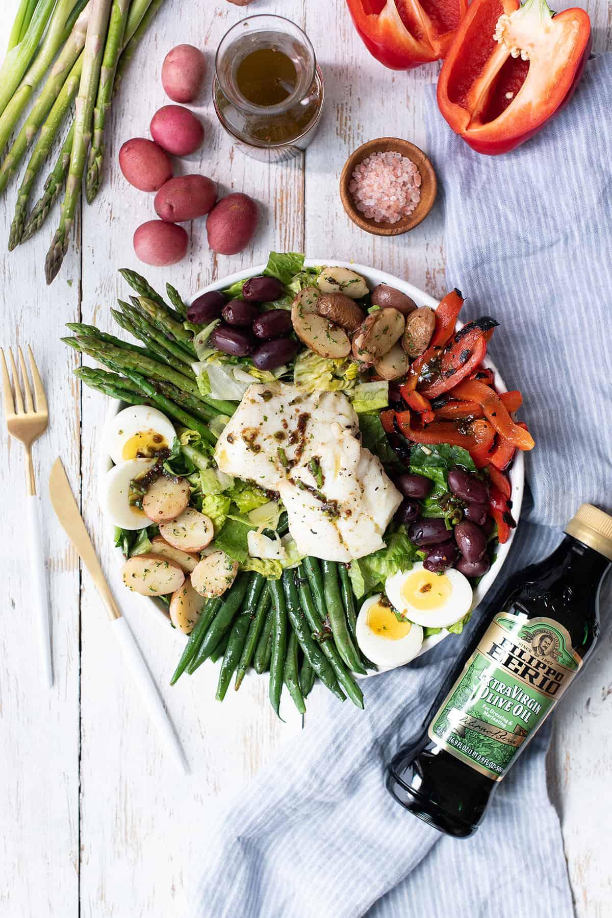 poached cod salad + olive oil bottle