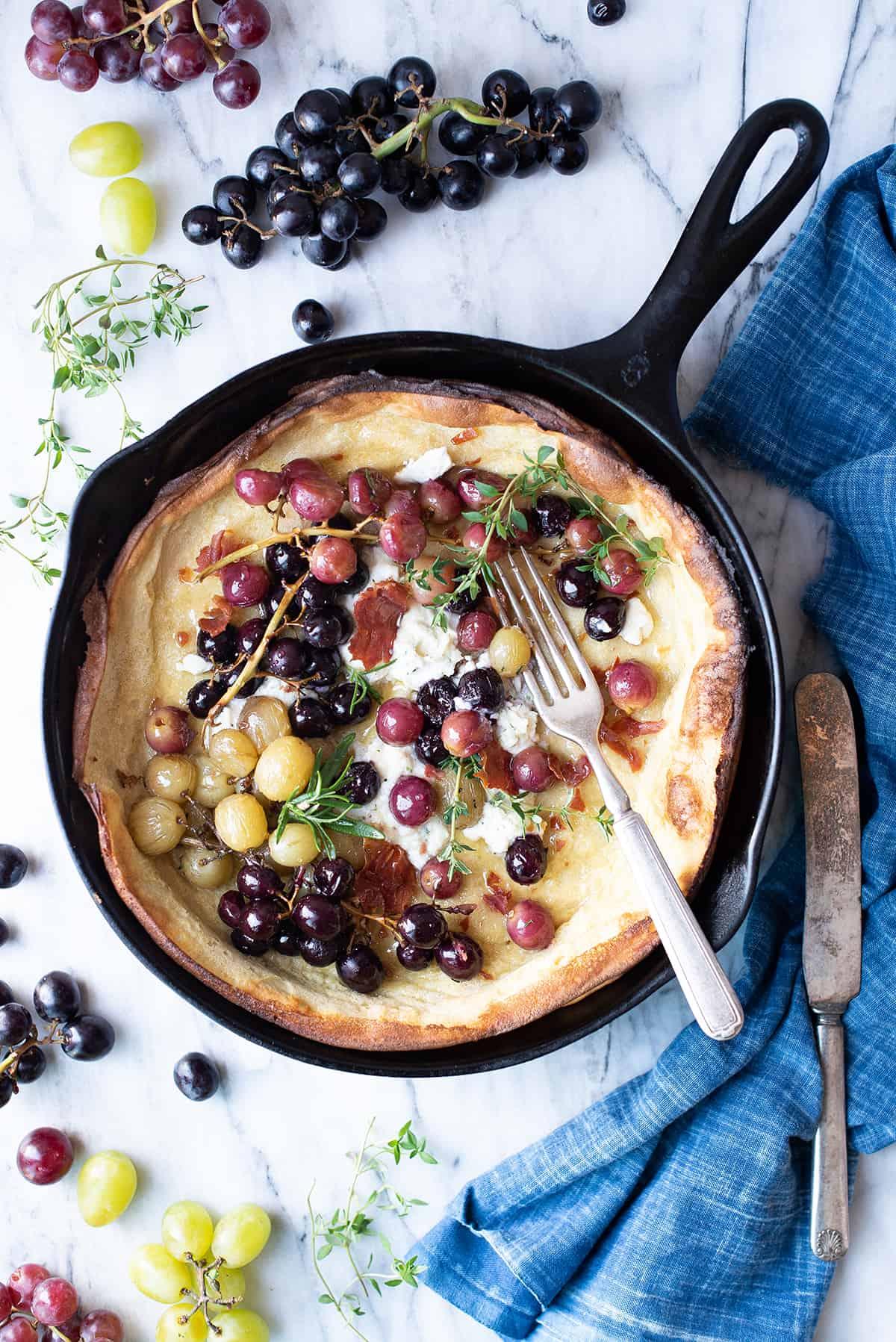 Grape Dutch Baby in cast iron pan