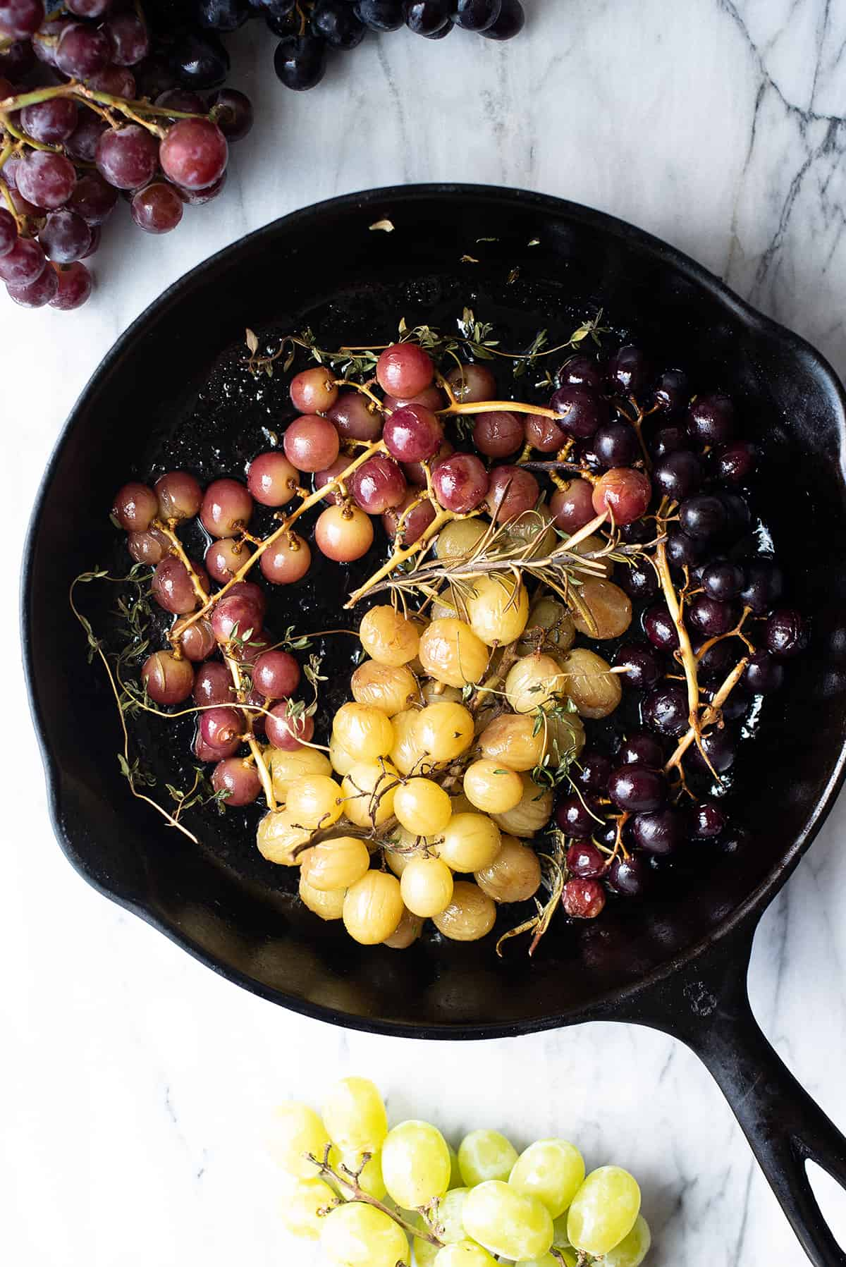 roasted grapes + herbs in cast iron pan