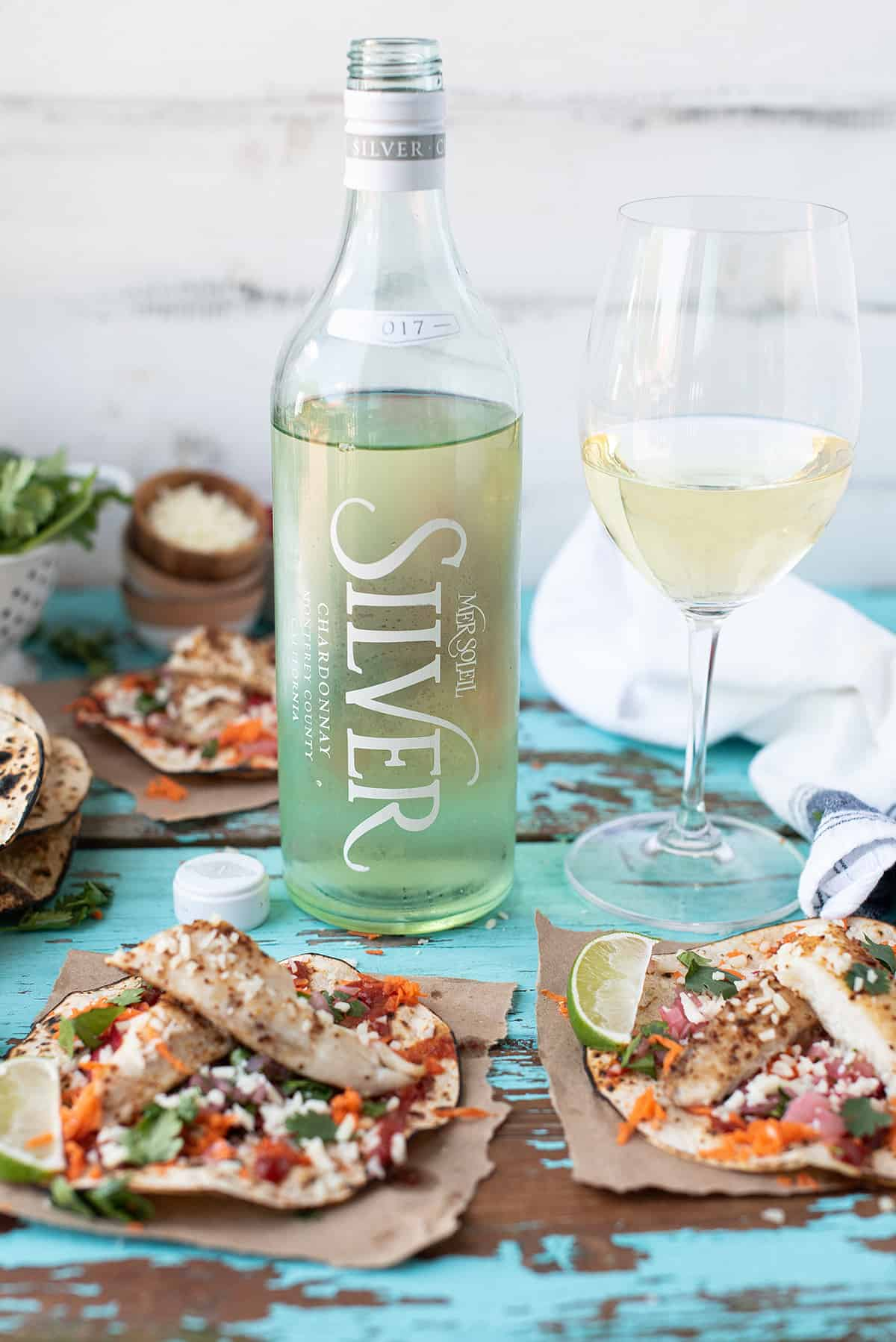 Mer Soleil SILVER bottle, wine glass with fish tostadas