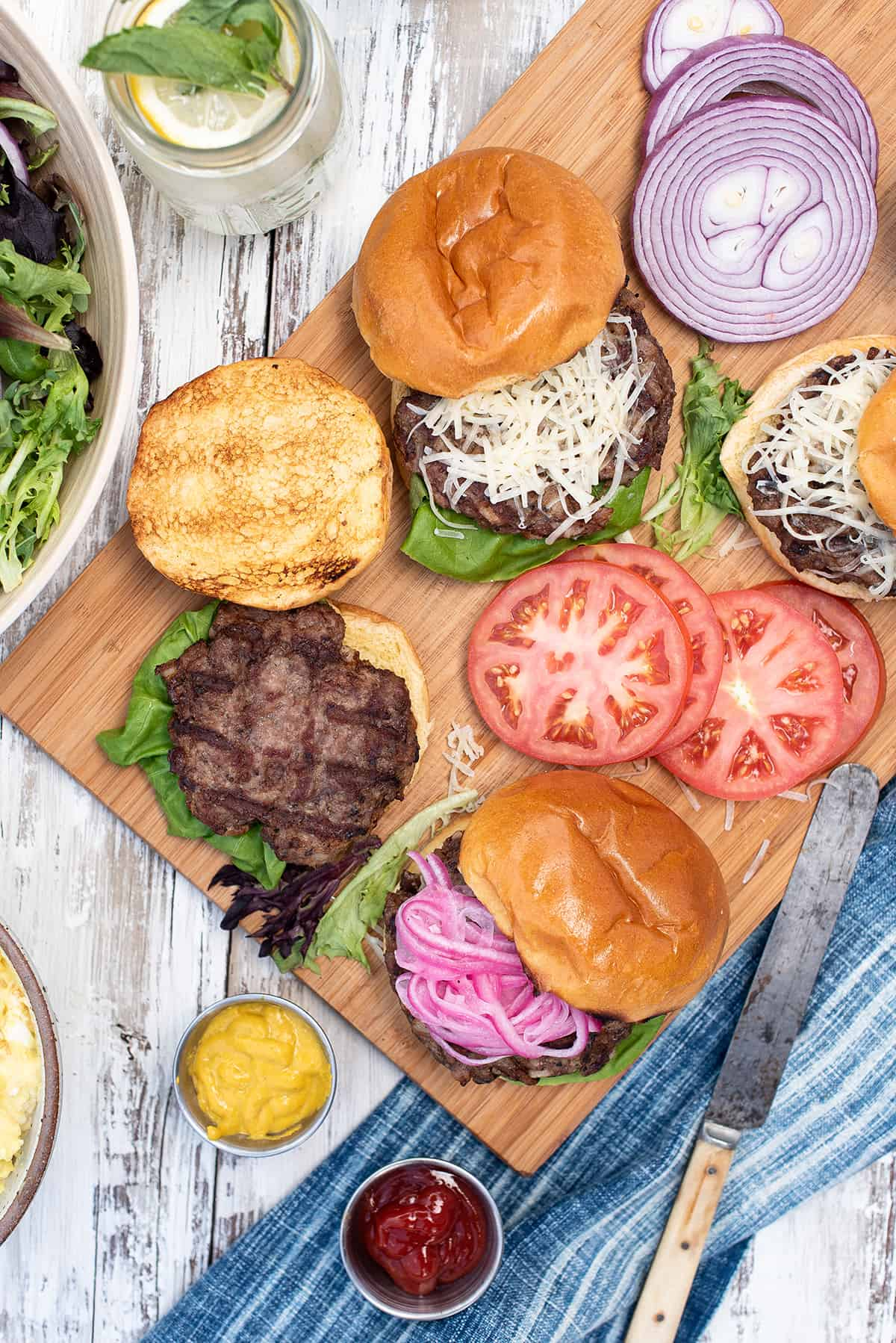 burgers on a platter, with toppings
