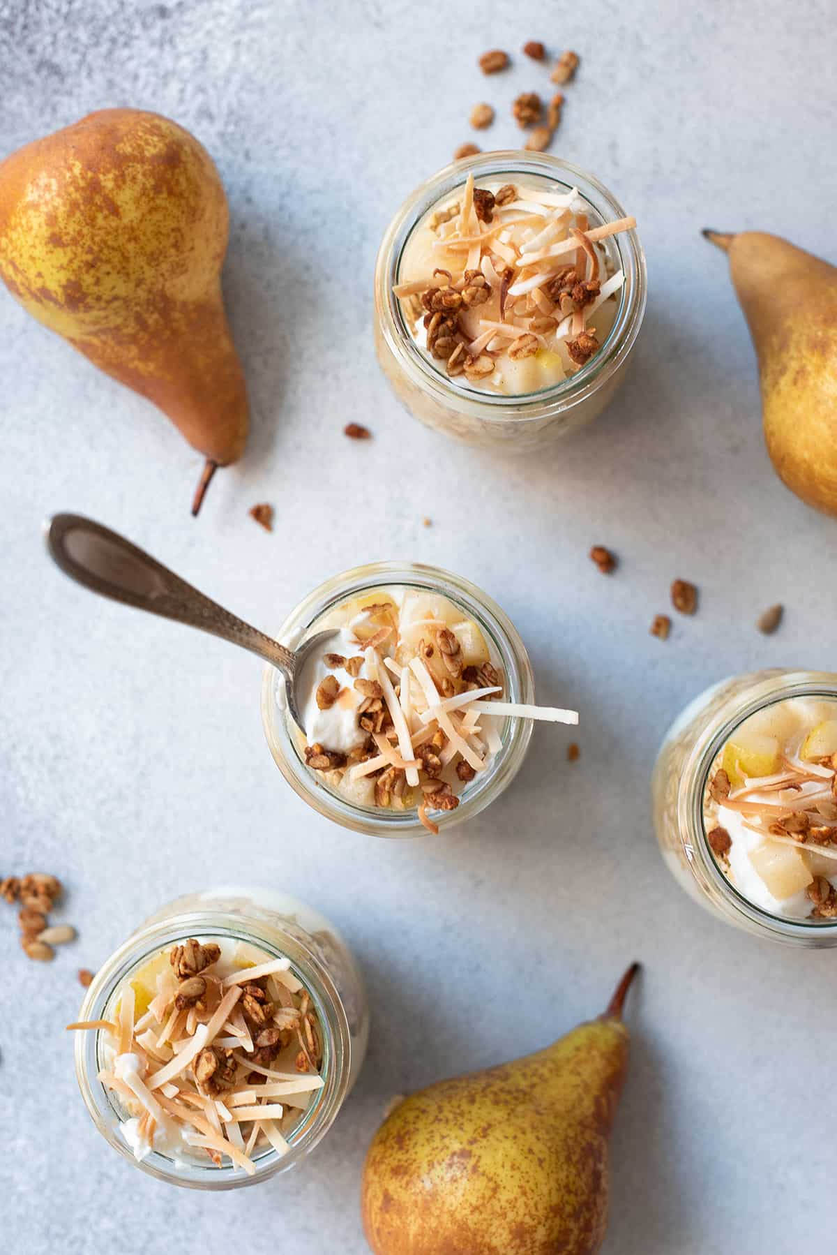 overnight oats pear parfaits with pears & spoons
