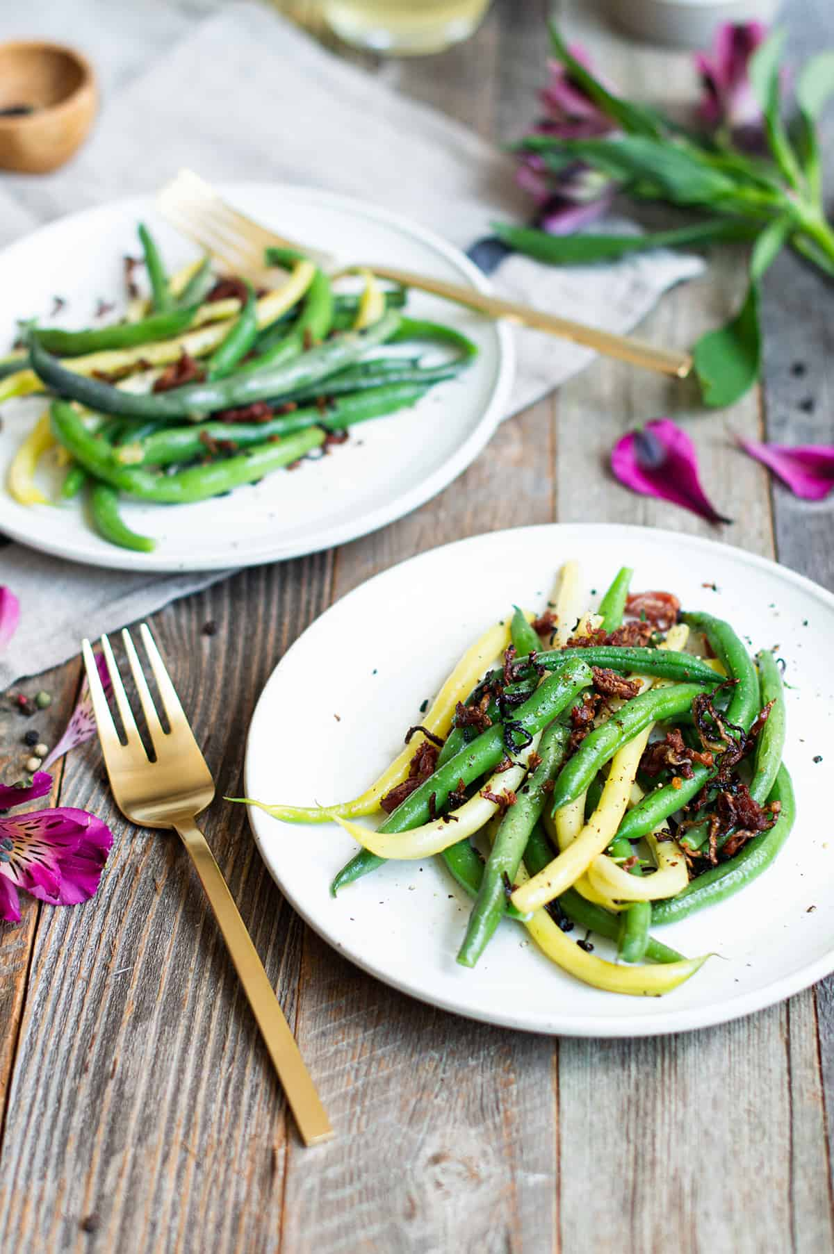 string beans on white plate with gold fork