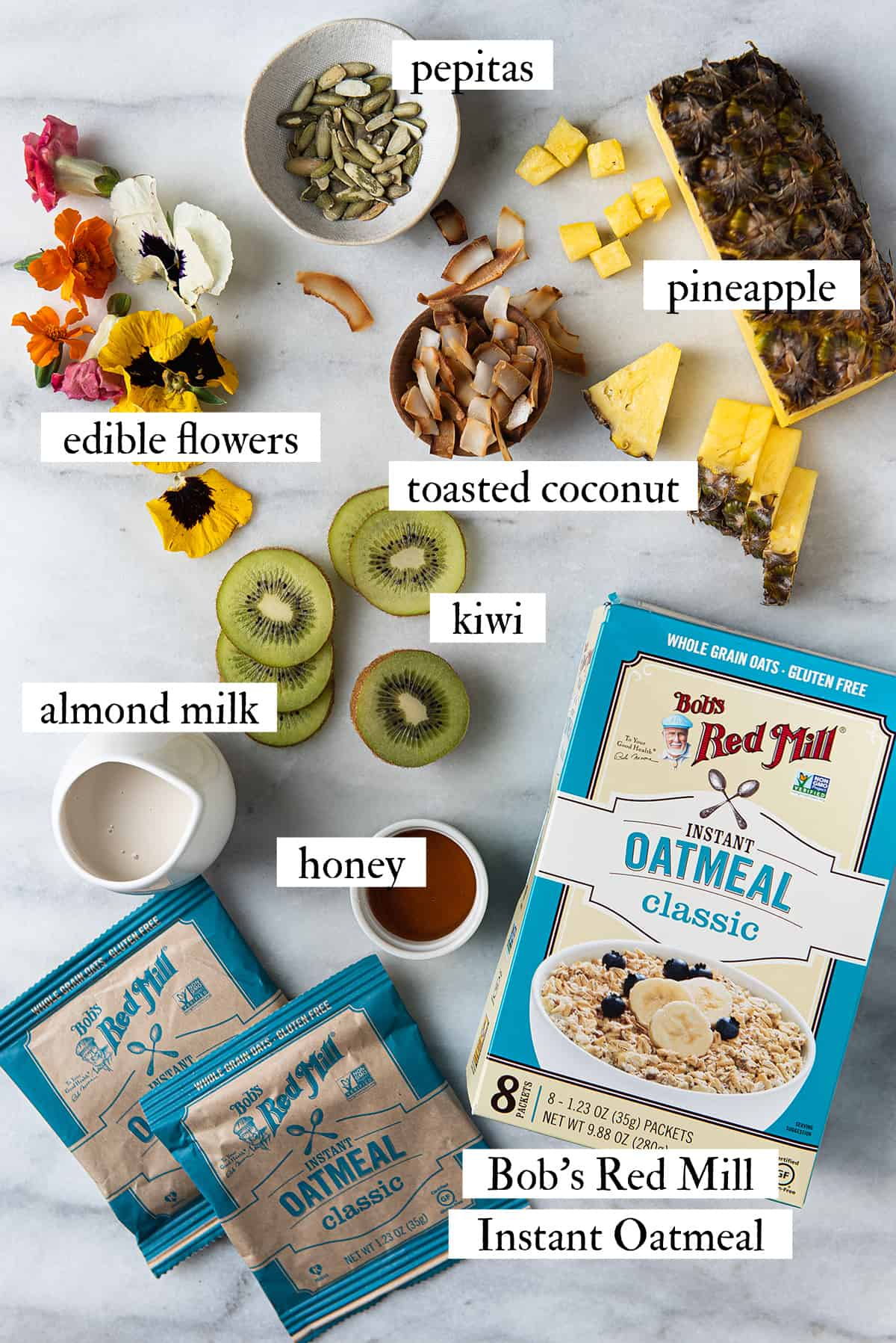 ingredients for oatmeal bowl on marble surface