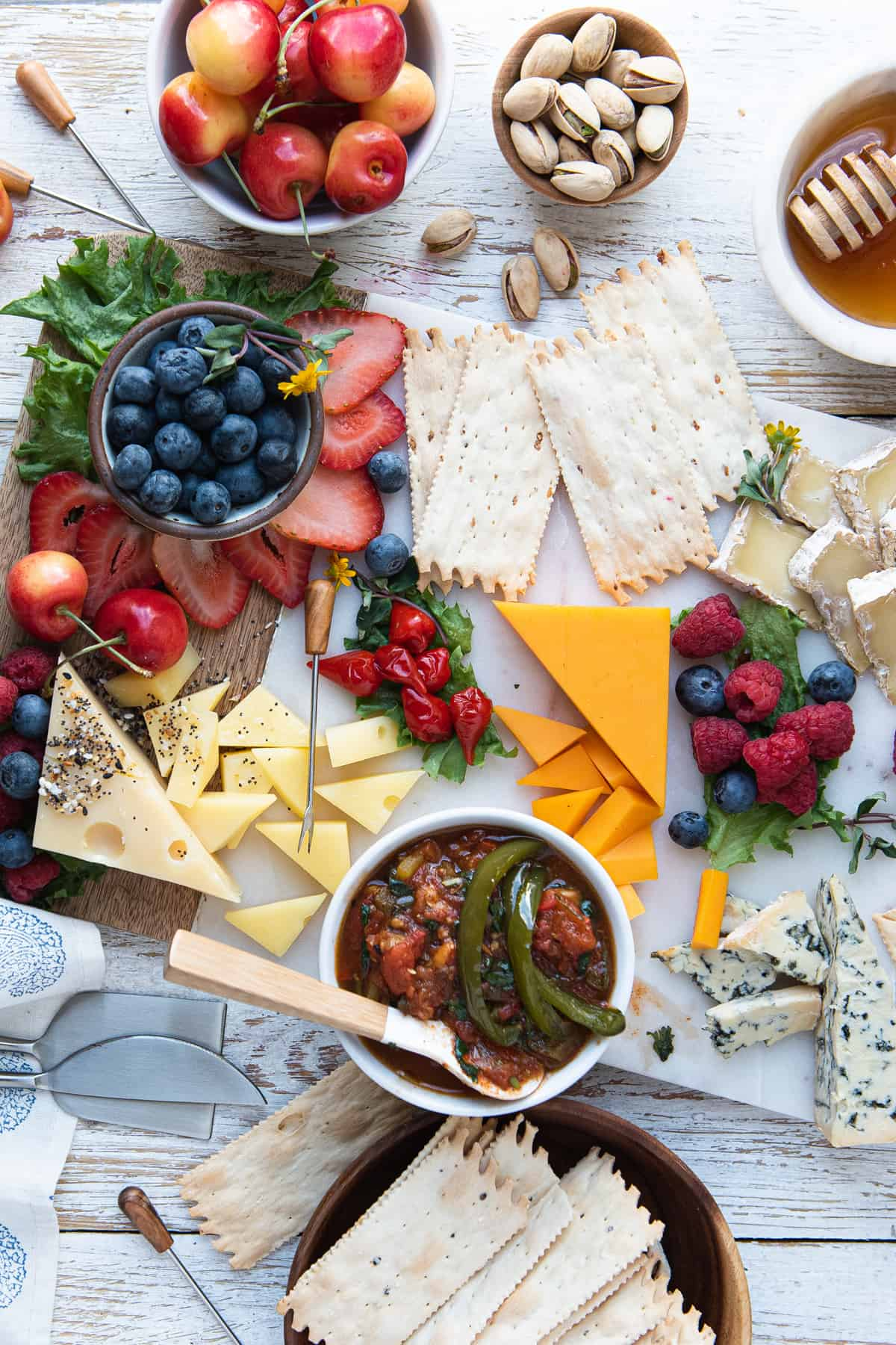 summer grazing board with cheese, crackers, fruit, and jam