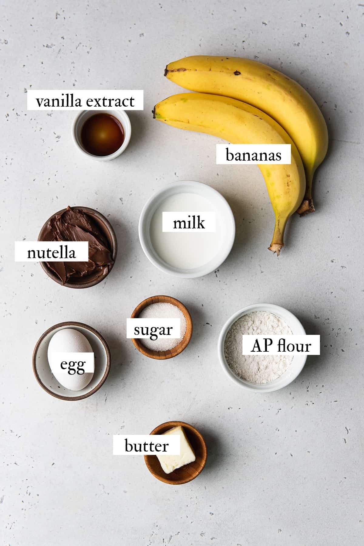 ingredients for German pancakes on white surface